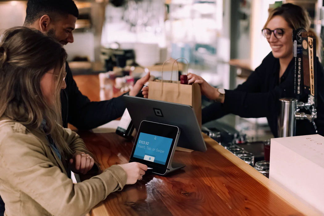 Customer using a tablet to pay for product that is connected to restaurant marketing